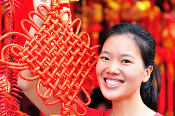 young asian woman hold a chinese knot wishing a happy new  year