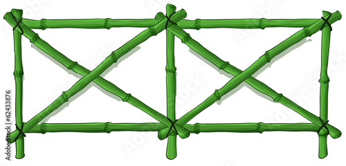 A green bamboo fence