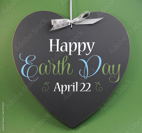 Happy Earth Day April 22 greeting on heart blackboard