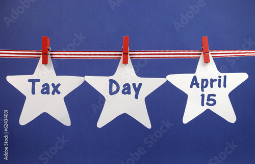 Tax Day April 15 reminder stars from pegs on a line