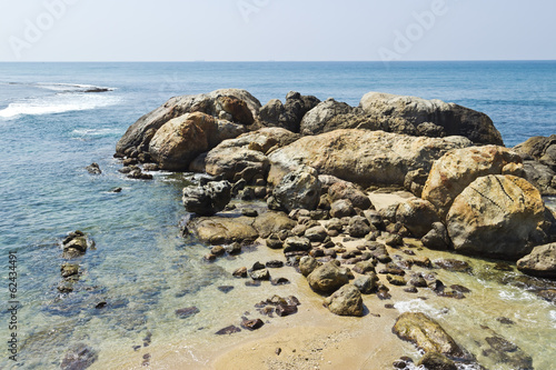 Large stones in water at coastline of Indian ocean