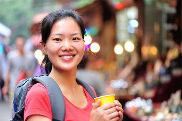 asian woman holding cup of coffee at xian street