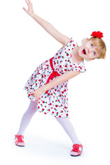Cheerful little girl with red rose, braided hair, joking in the