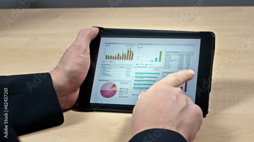 Swiping through business reports on tablet device
