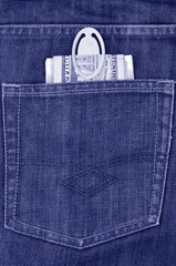 Money in the back pocket of jeans