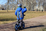little boy riding runbike, early sport