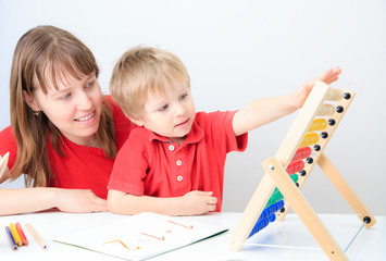 mother and son playing with abacus