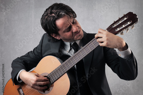 guitarist businessman
