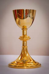 Gold holy chalice on church altar