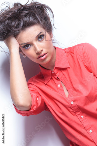 casual young woman with hand in hair