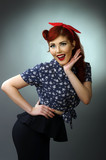 Happy young woman posing in retro outfit