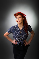 Pin up girl posing with hands on hips