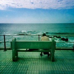 man looking at the sea