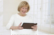 Closeup of senior woman  with electronic Ipad