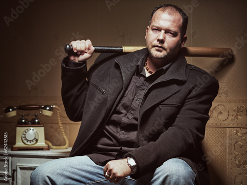 Vintage style photo from a bad guy with a baseball bat