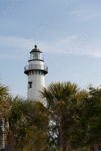 White Lighthouse Behind Palm Trees