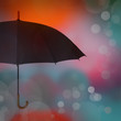Umbrella on blue orange background with bokeh