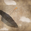 Fun flying umbrella on grungy background with clouds