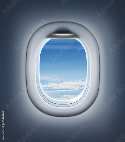 Fotobehang Vliegtuig Airplane interior or jet window with clouds and sky.