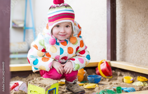 cute little girl in a sandbox