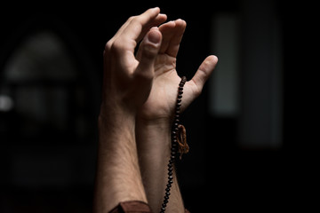 Hands Holding A Muslim Rosary