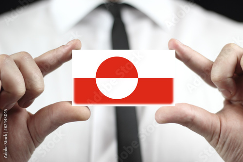 Businessman holding a business card with Greenland Flag