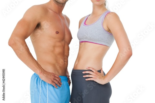 Mid section of a fit young couple