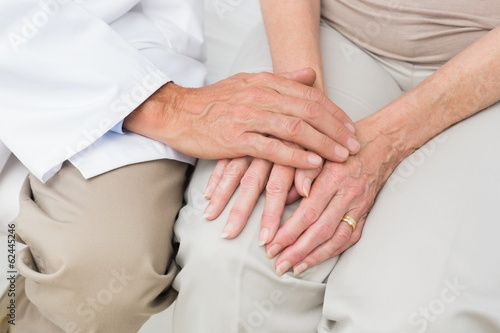 Mid section of a senior patient visiting doctor
