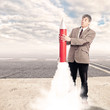 businessman holding a rocket