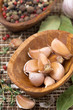 garlic cloves in a wooden bowl closeup
