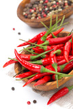 bowl with fresh chili pepper, isolated on white