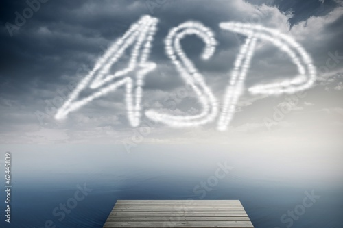 Asp against cloudy sky over ocean