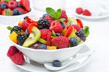 salad of fresh fruit and berries in a white bowl, berries