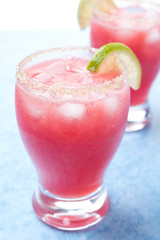 watermelon cocktail with brown sugar and lime in a glass