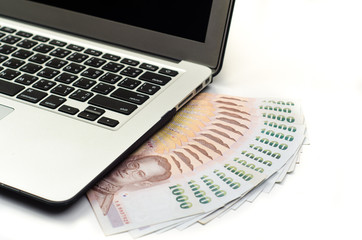 laptop keyboard and money
