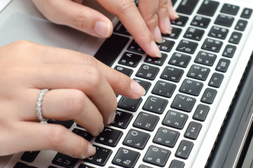 Typing on keyboard. female finger