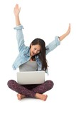Asian woman cheering with laptop sitting on floor