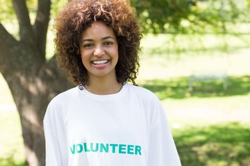 Confident female volunteer in park