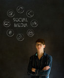 Business man or teacher with chalk social media icons