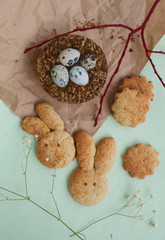 Easter quail eggs and homemade rabbit shape cookies