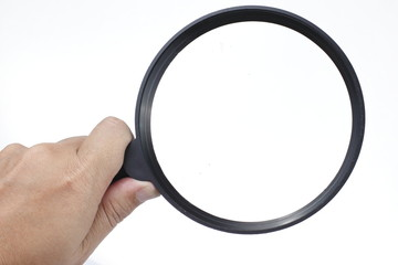 Hand Holding Magnify Glass on White background