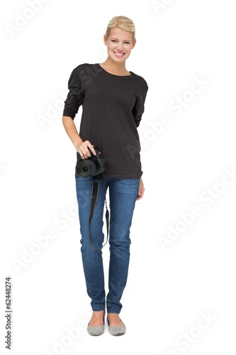 Full length portrait of a female photographer