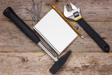 Construction tools and blank notebook