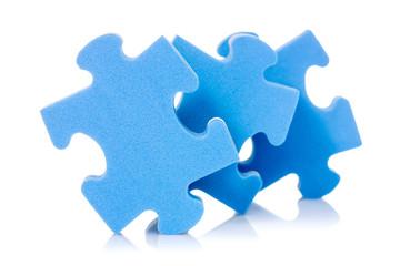 Three puzzle pieces on white