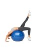 Fit young woman stretching on fitness ball