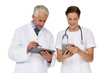 Male and female doctors with digital tablets
