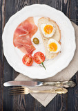 Breakfast prosciutto ham and boiled egg