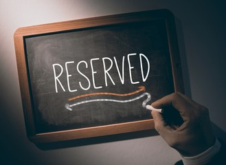 Hand writing Reserved on chalkboard