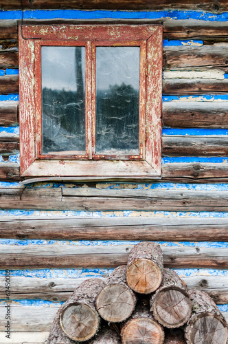 Vertical view of old rustical wooden window.
