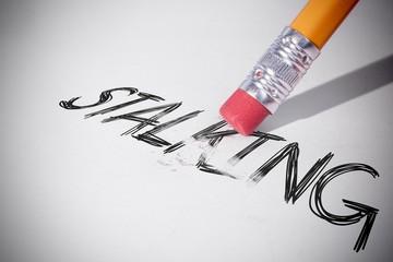 Pencil erasing the word Stalking